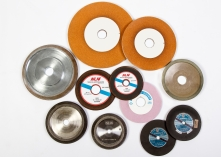 Abrasive grinding wheels for band saws